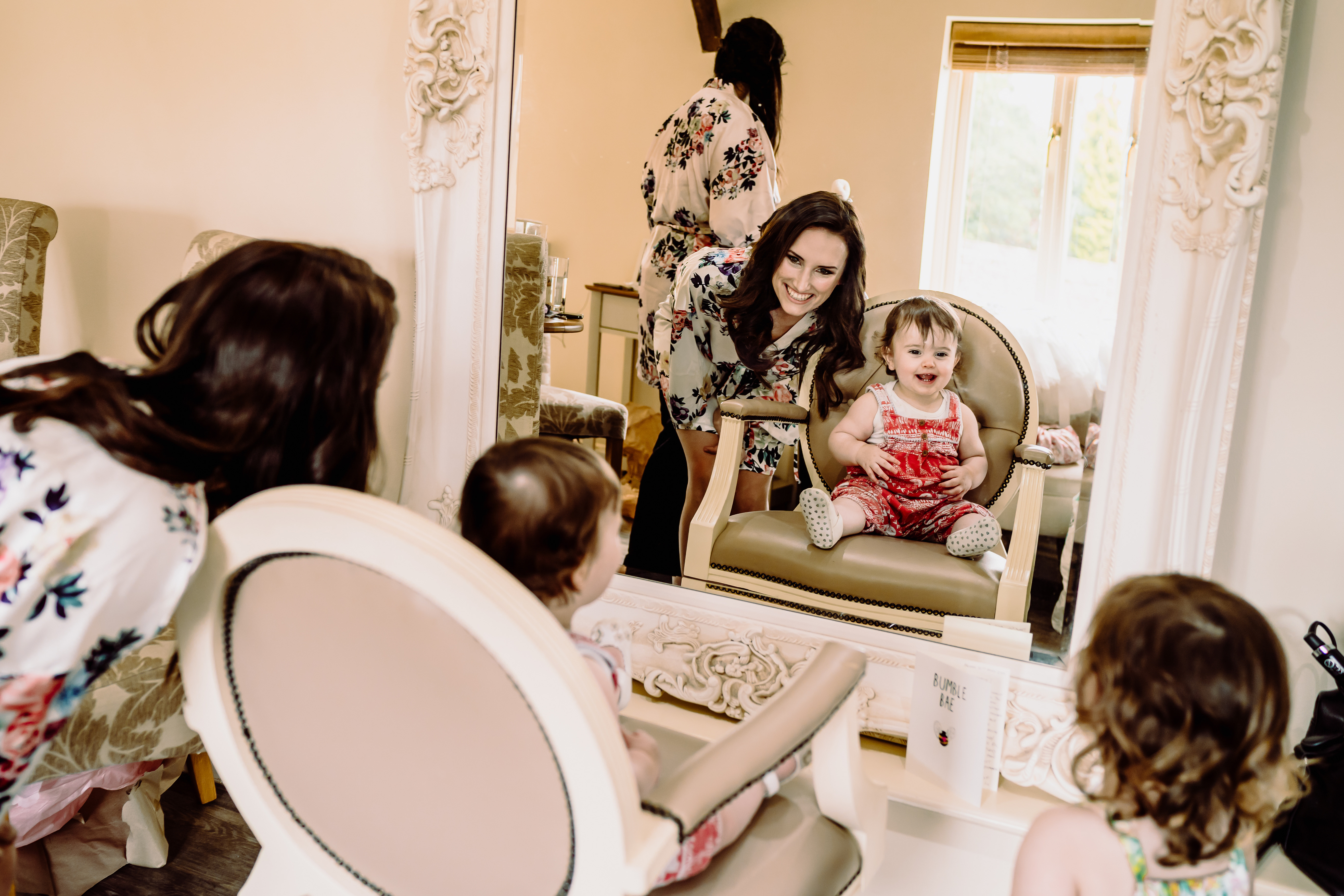a bride has fun with a flower girl at her wedding