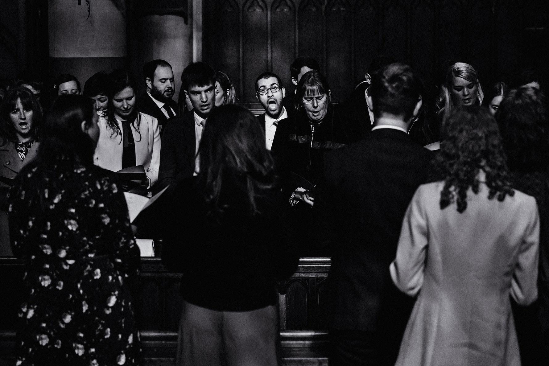 a wedding guest singing a hymn