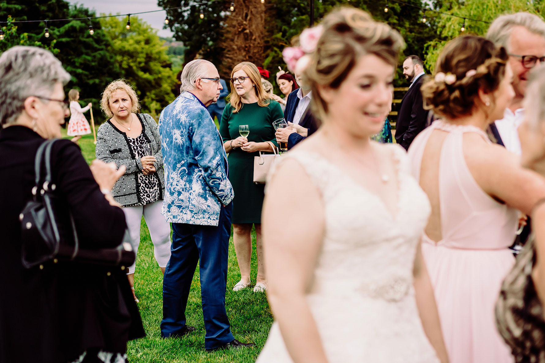 a wedding guest peeks at the wedding dress