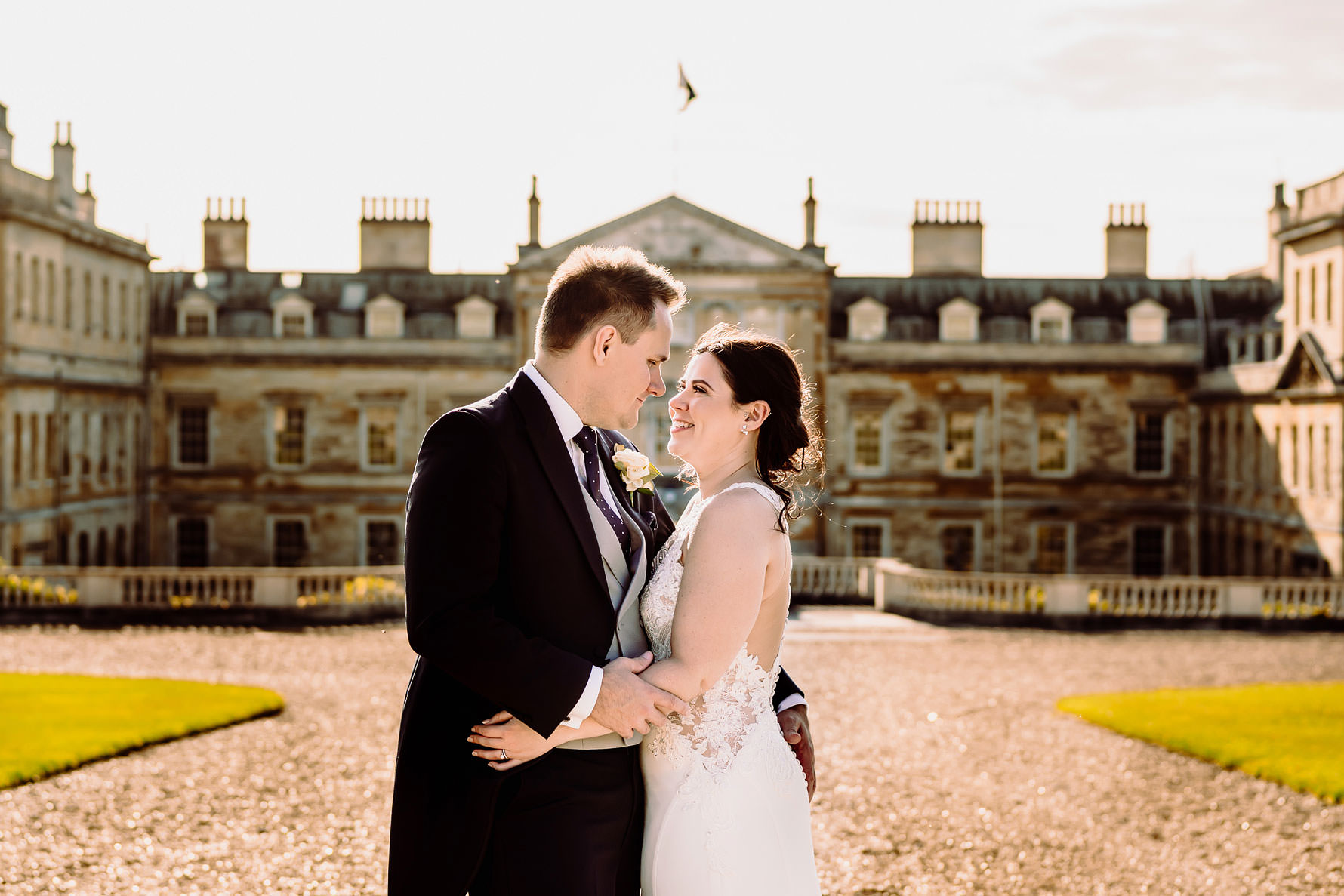 a happy bride and groom outside Woburn abbey