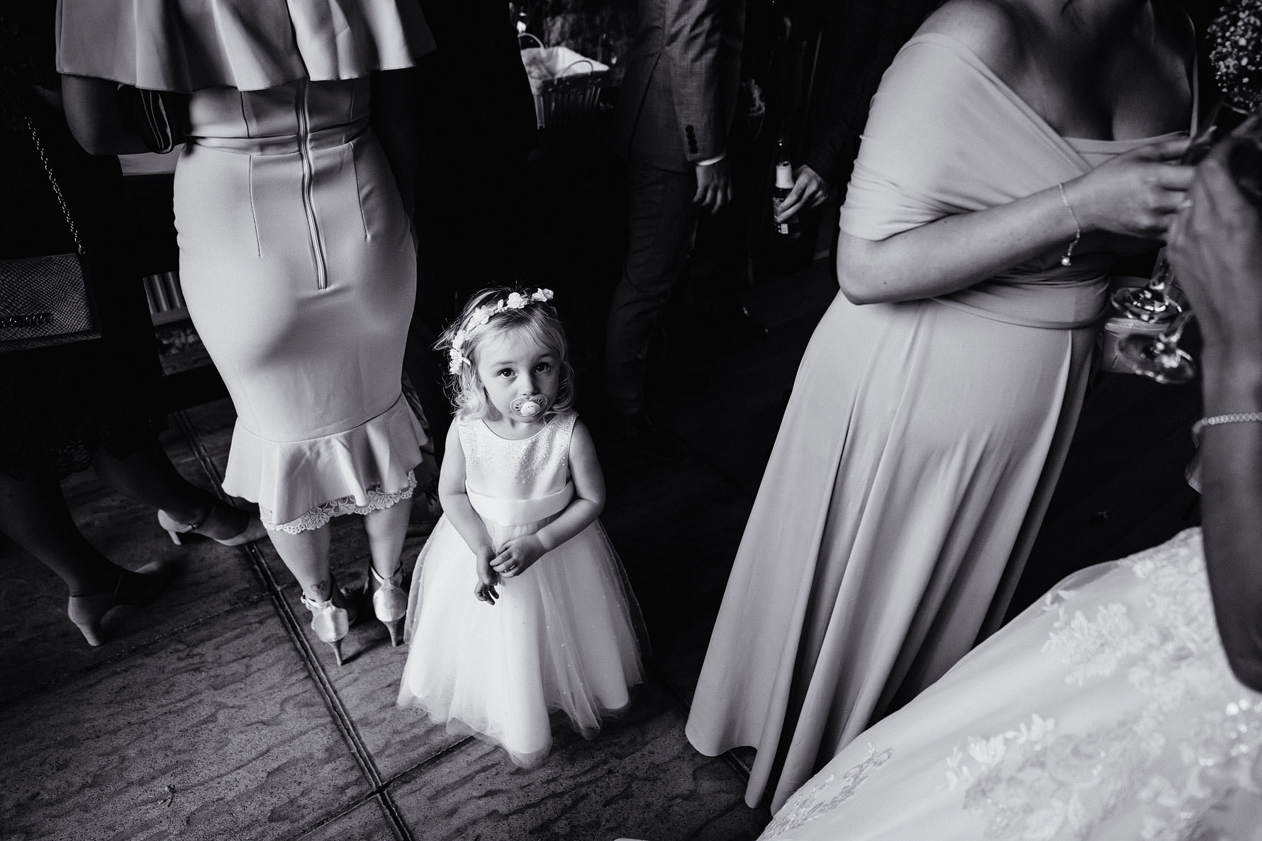 a little flower girl with a dummy