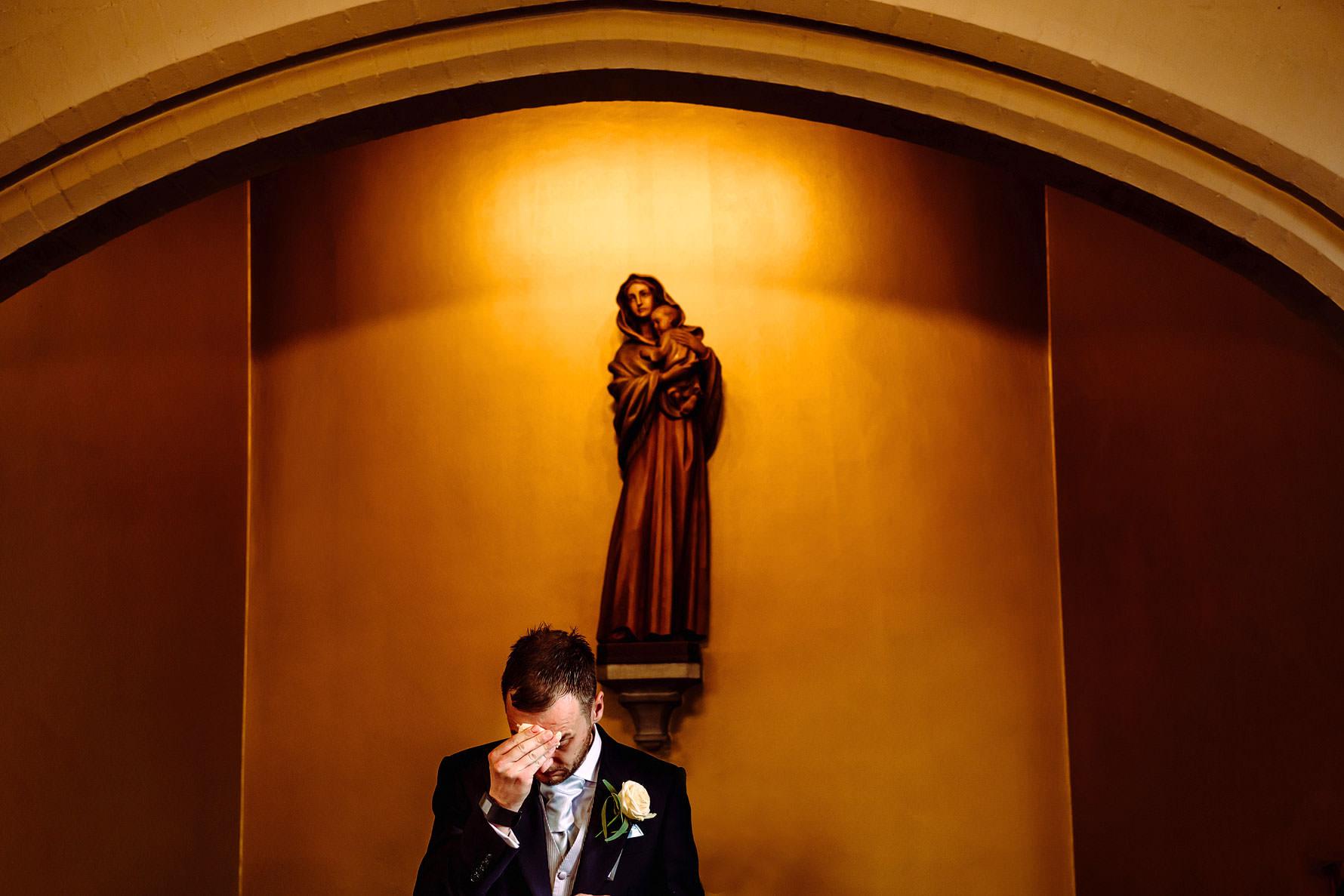 a groom under the Virgin Mary