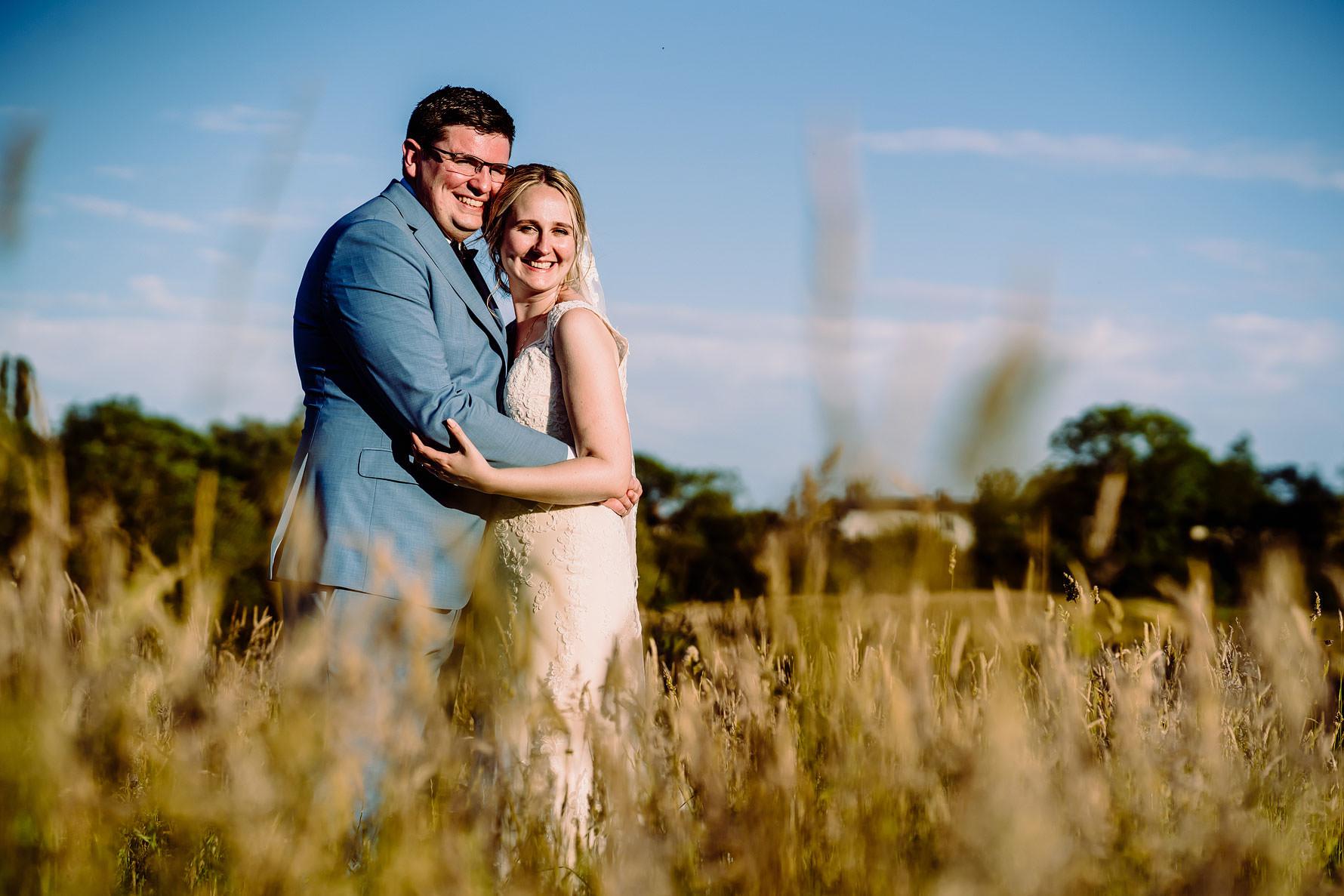 a wedding photo in a field