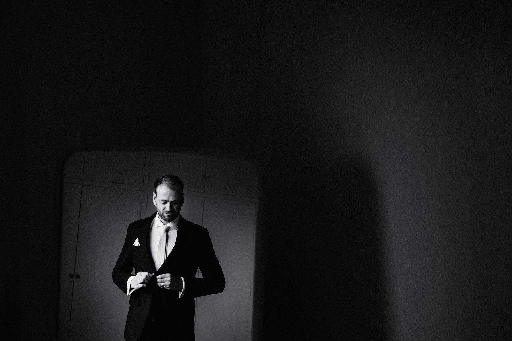 a creative portrait of a groom