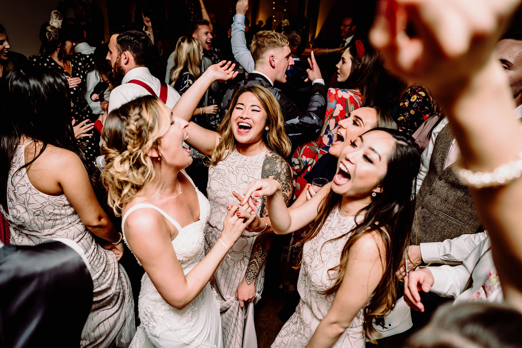 a bride dances with her friends at Dodford manor