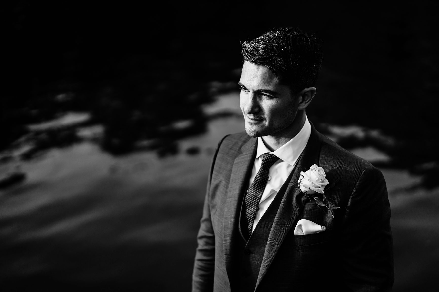 a handsome groom in black and white
