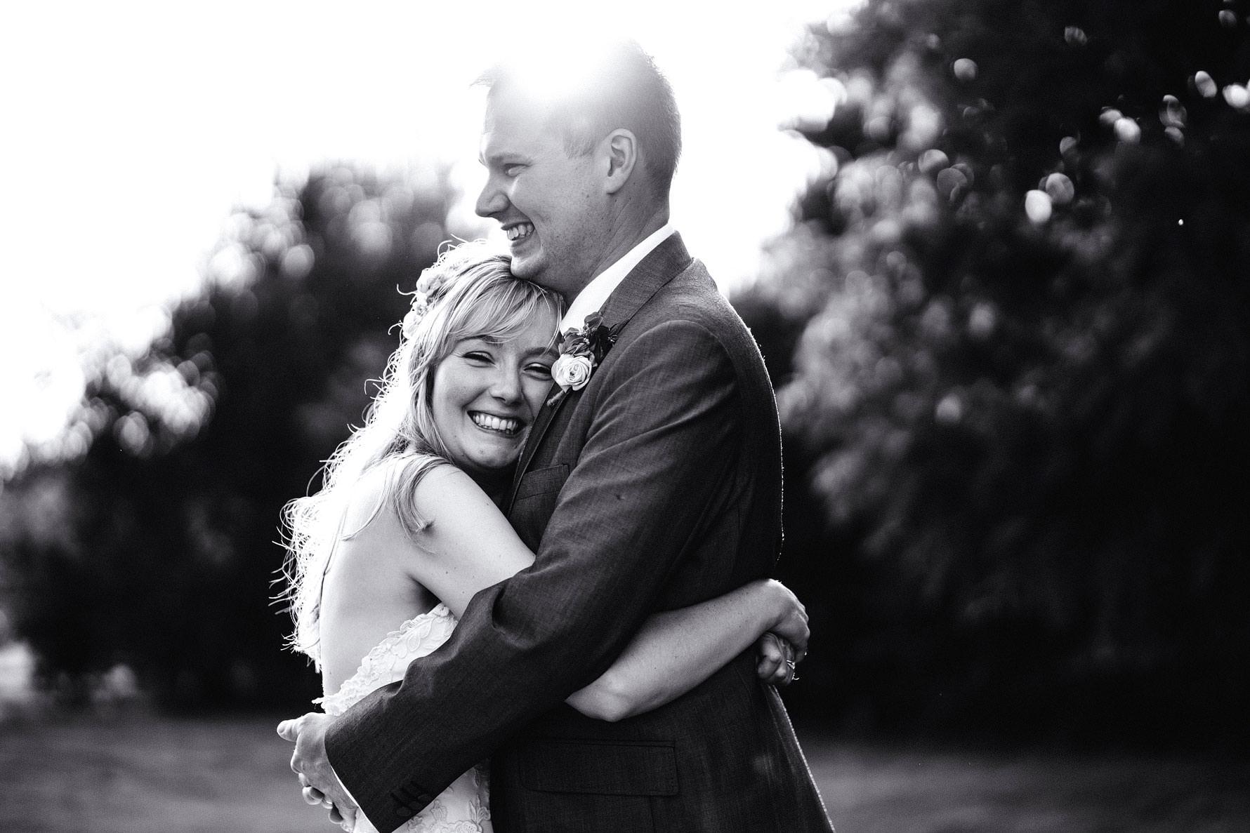 a happy couple embrace