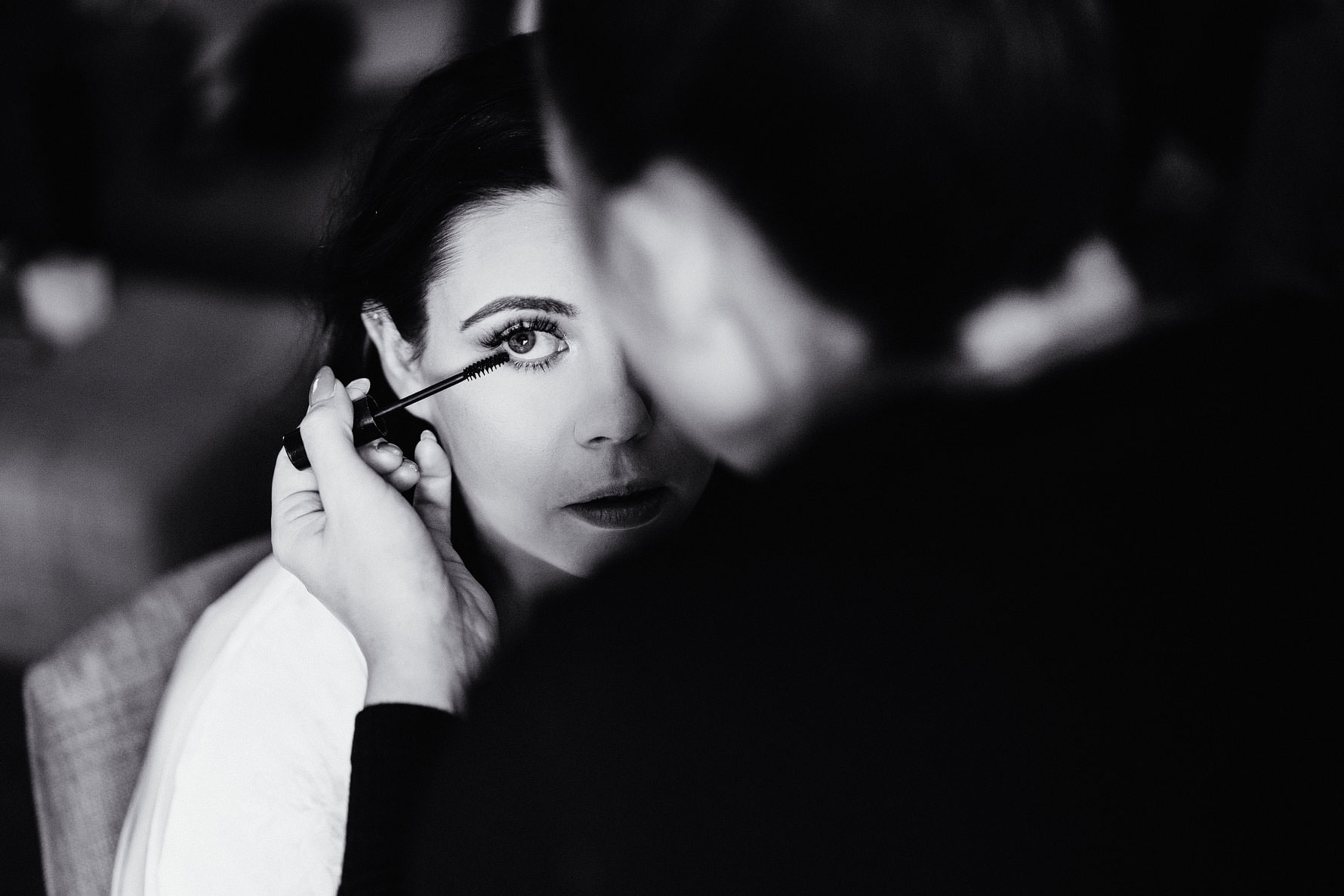 a bride has her make up applied