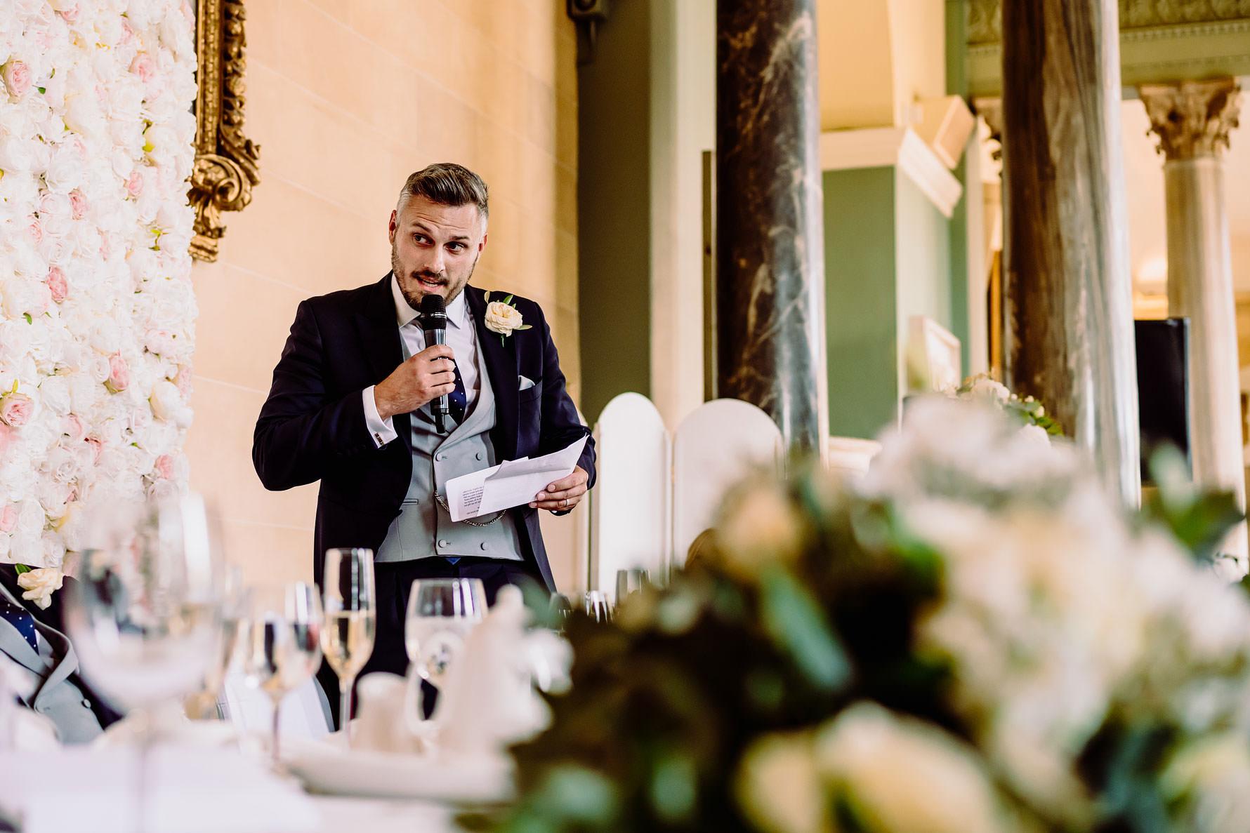 the bestman delivering his speech