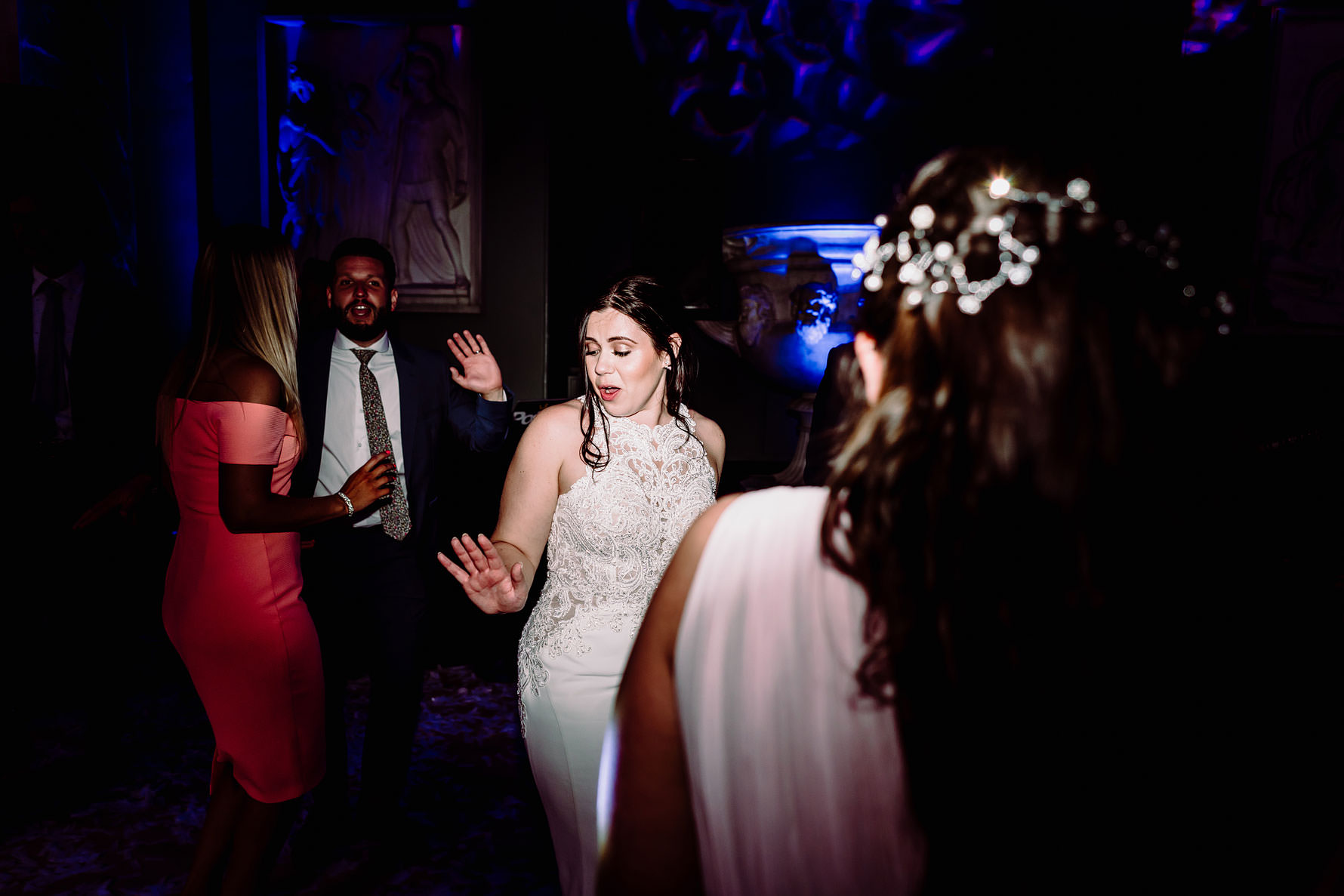 a bride dances with friends