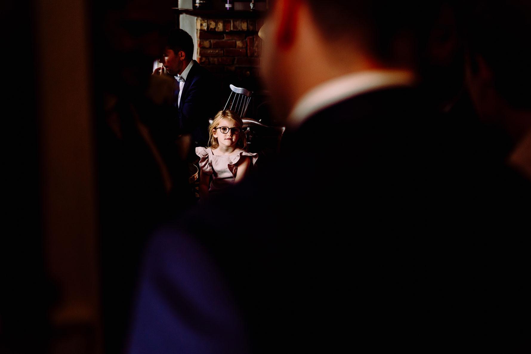 a little girl at a wedding