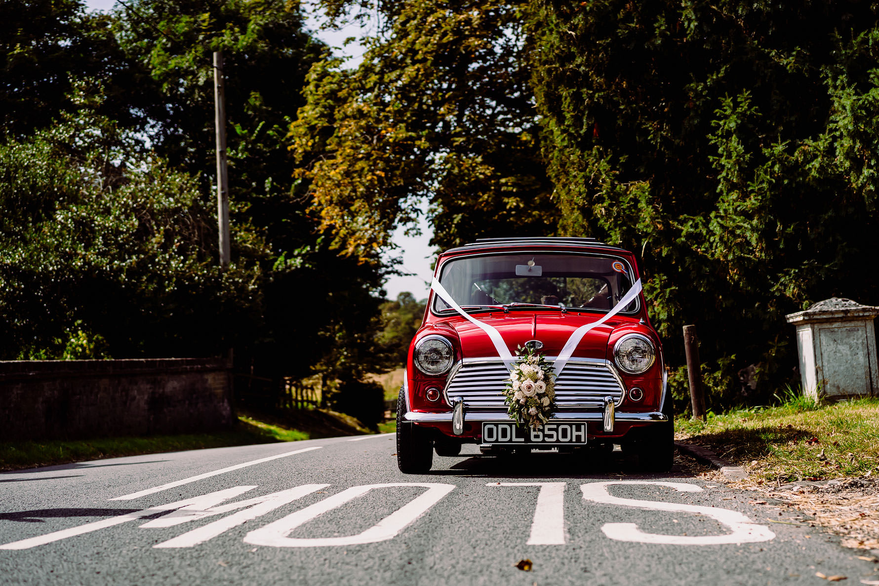 a red mini cooper at a wedding