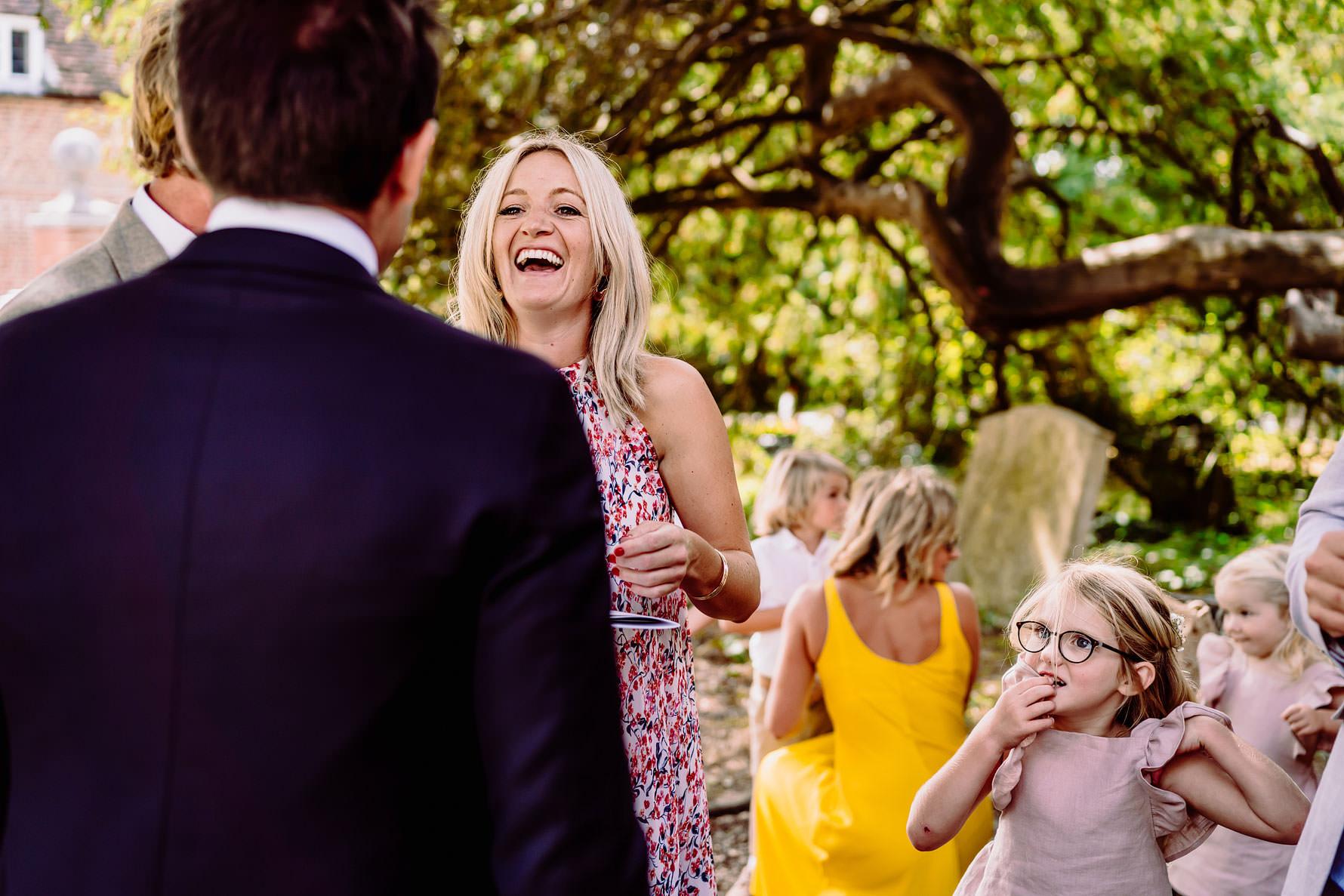 a happy wedding guest