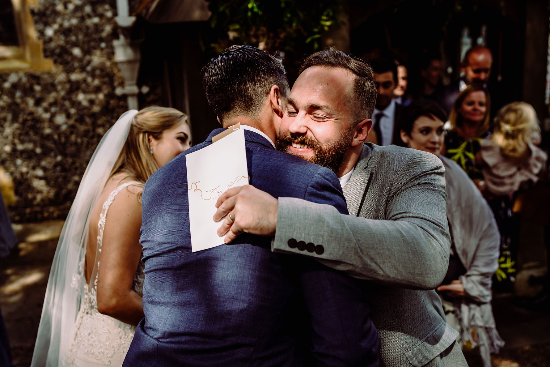 a gent congratulates the groom