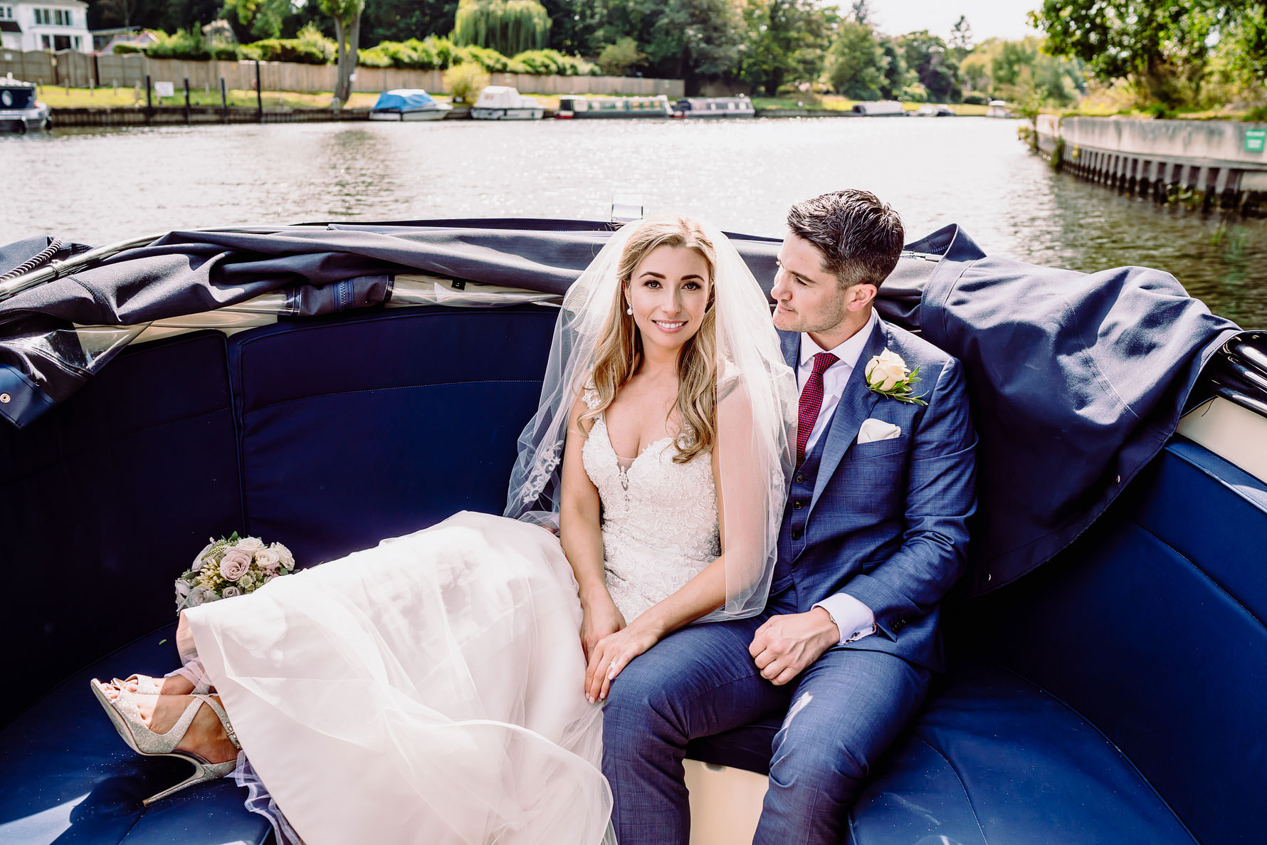 a bride and groom on a boat