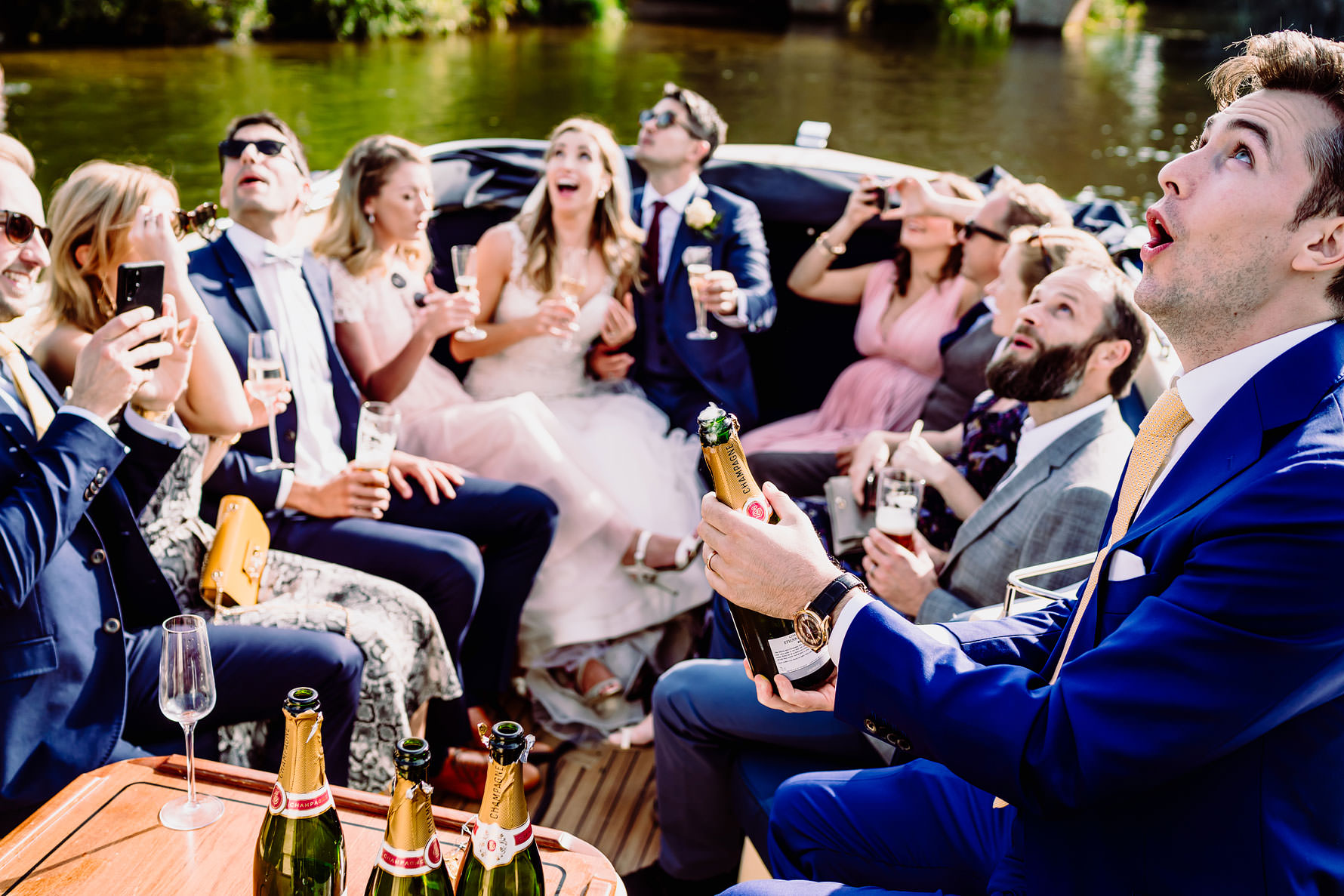 popping champagne at a wedding on the thames
