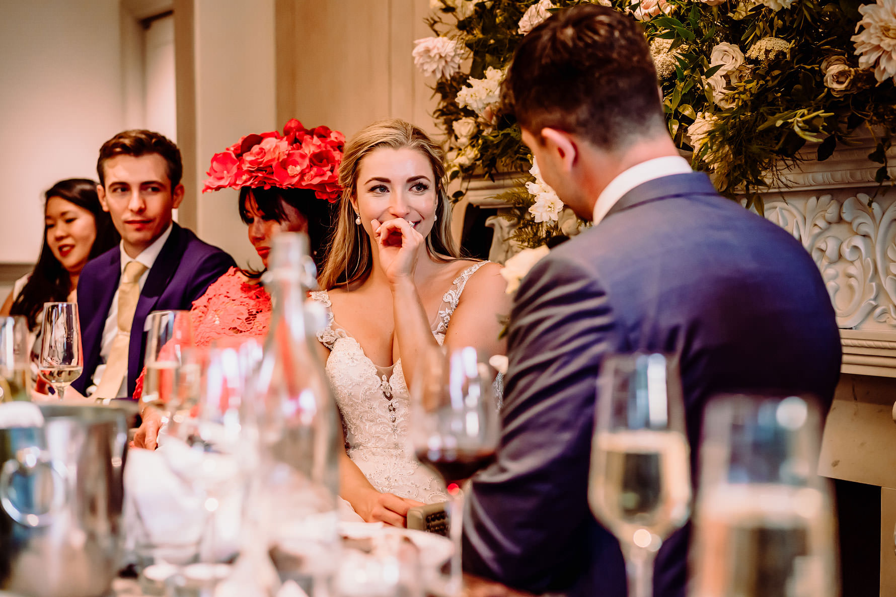 an emotional bride during the grooms speech