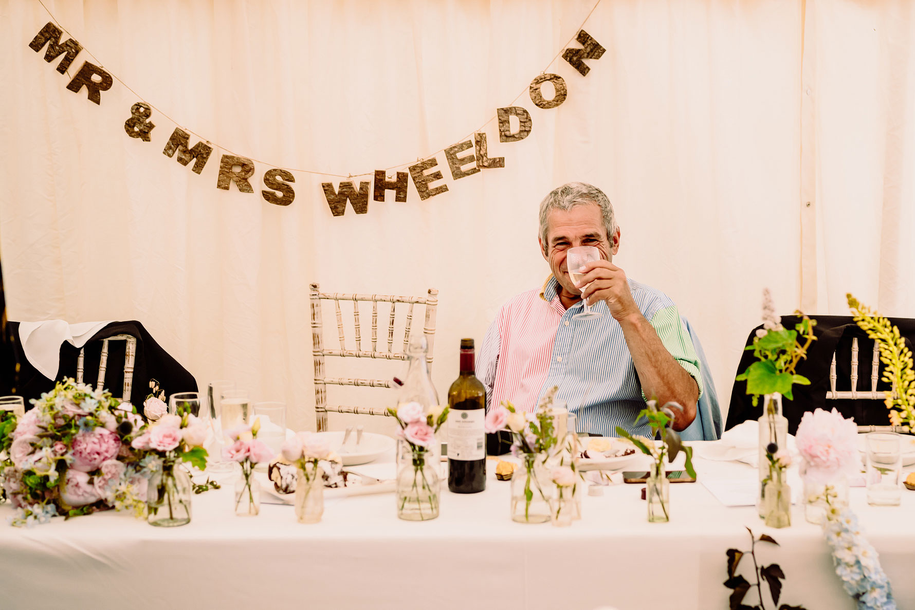 the father of the groom enjoying a drink