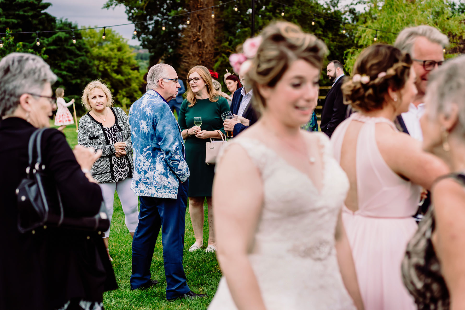 a wedding guest looks at the wedding dress